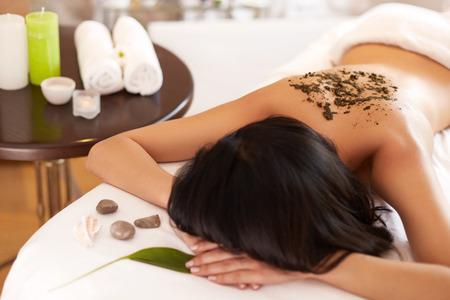 salon and spa: Spa Woman. Brunette Getting a Marine Algae Wrap Treatment in Spa Salon