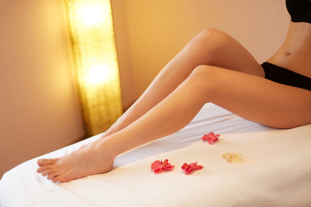 Long Woman Legs. Young Woman Cares About Her Legs. Stock Photo