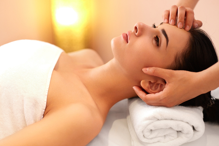 beauty therapist: Face Massage. Close-up of a Young Woman Getting Spa Treatment.