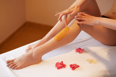sugaring: Long Woman Legs. Woman Cares About Her Legs. Sugaring Treatment