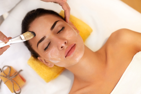 woman face cream: Face Treatment. Woman in Beauty Salon Gets Marine Mask