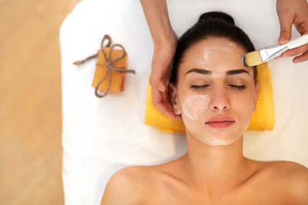 facial: Face Treatment. Woman in Beauty Salon Gets Marine Mask