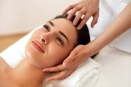 salon and spa: Beautiful Young Woman Getting a Face Treatment at Beauty Salon.