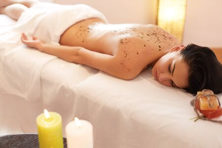 spa beauty: Woman Gets a Marine Algae Wrap Treatment in Spa Salon