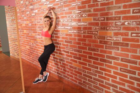 girl legs: Portrait of young sporty girl doing stretching exercise Stock Photo
