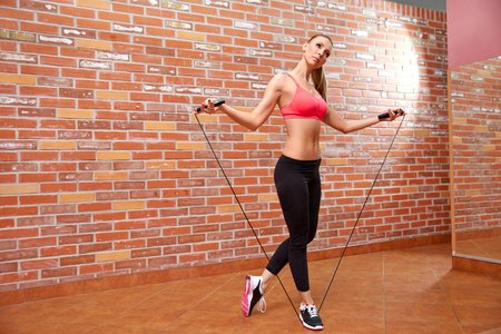 skipping rope: Healthy young woman with jump rope Stock Photo
