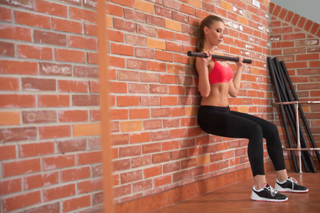 Healthy Woman Working Out With Dumbbells