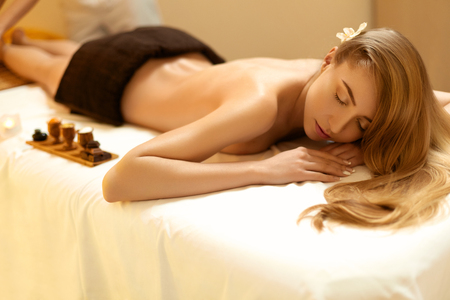 natural beauty: Spa Woman. Blonde Gets Recreation Treatment in Spa Salon. Wellness Concept