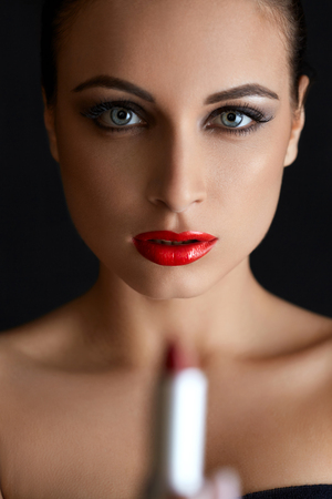 lady in red: Portrait of Beautiful Woman With Red Lipstick. Red Lips