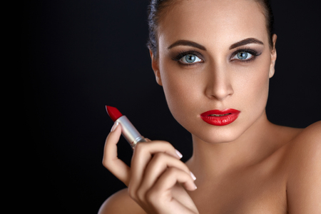 lips: Portrait of Beautiful Woman With Red Lipstick. Red Lips