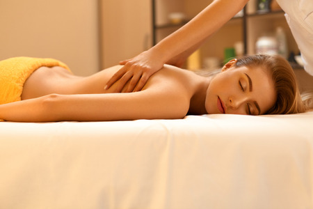 spa treatment: Spa Massage. Beautiful Blonde Gets Spa Treatment in Salon.