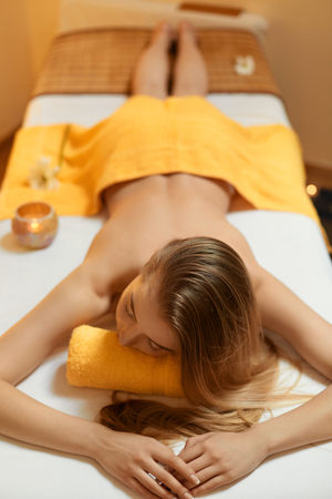 natural therapy: Spa Woman. Beautiful Blonde Relaxing in Spa Salon Stock Photo