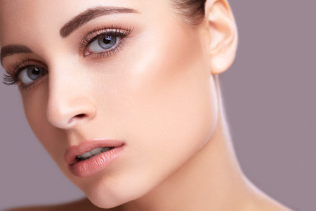 face to face: Closeup beauty face portarit of young healthy beautiful woman