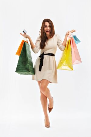 shopper: Happy Woman Shows a Shopping Bags. Isolated on white.