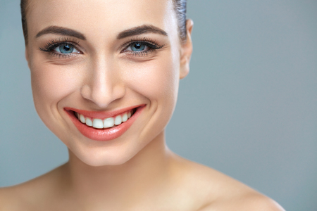 smile close up: Woman smile. Teeth whitening. Dental care. Stock Photo