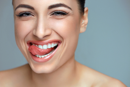 care: Woman smile. Teeth whitening. Dental care. Stock Photo