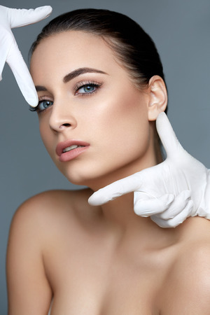 lift hands: Cosmetic surgery. Beautiful Woman before Plastic Operation. Beauty Face Stock Photo