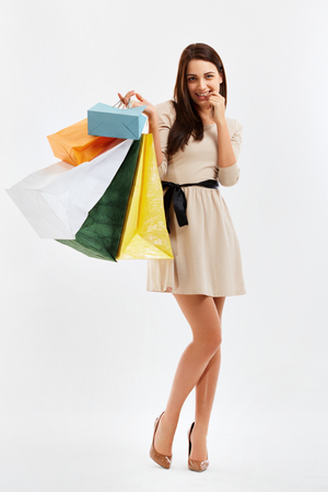 happy shopping: Happy Woman With a Shopping Bags. Isolated on white. Stock Photo