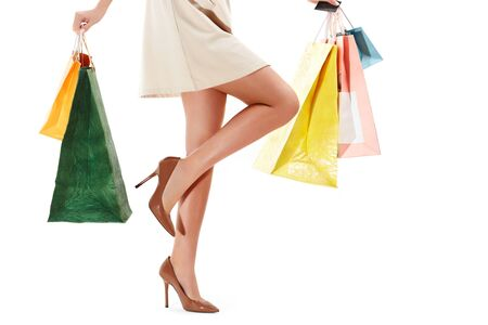 Womans legs and Shopping Bags Isolated on White Stock Photo