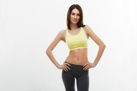 Fitness Woman against white background. photo
