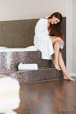 after bath: Beautiful Woman Cares About Legs After Bath Stock Photo