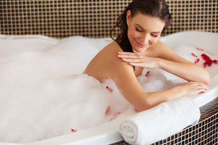 woman: Beautiful Woman in Bath Cares About Her Hands