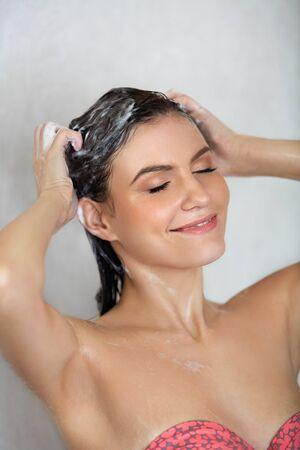 washing hair: Woman in shower washing hair.
