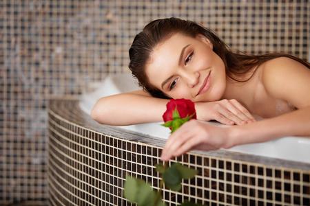 woman in bath: Beautiful Woman in bath with rose