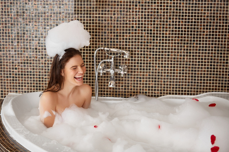 Beautiful Woman Plays With Bubbles in Bath