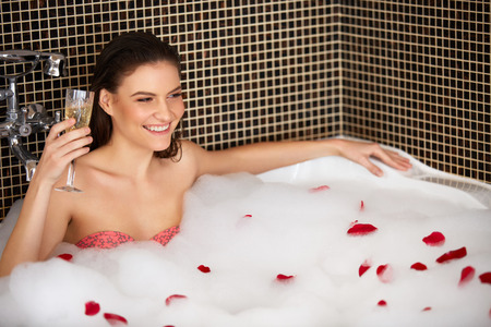 woman in bath: Beautiful Woman Takes Bubble Bath.
