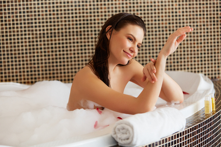 woman in bath: Beautiful Woman in Bath Cares About Her Hands