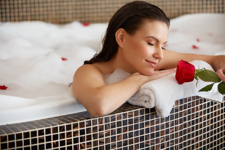 baths: Beautiful Woman Relaxing in Bath With Rose
