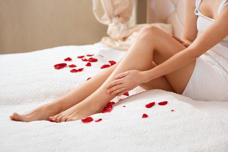 beautiful legs: Beautiful Woman Cares About Legs Stock Photo