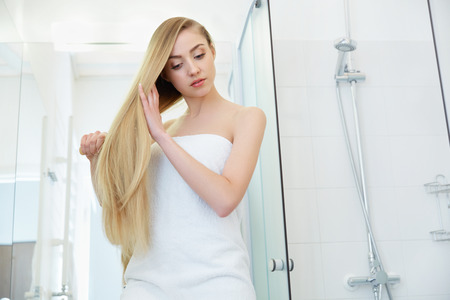 long: Beautiful Blond Brushing Her Hair