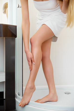 women legs: Beautiful Woman Cares About Legs Stock Photo