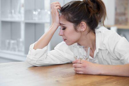 depressed: Portrait of woman with headache Stock Photo