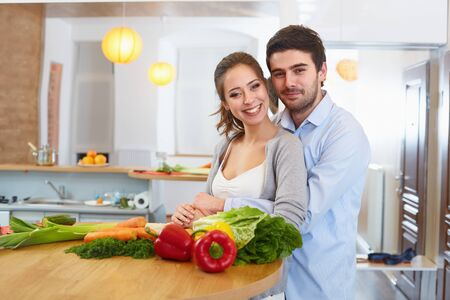 ooking: Young Сouple Сooking in The Kitchen. Healthy food