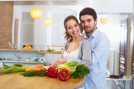 сooking: Young Сouple Сooking in The Kitchen. Healthy food