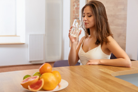healthy lifestyle: Young Woman with glass of Water. Healthy Lifestyle Stock Photo