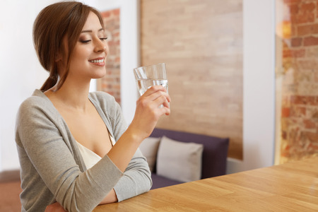 Young Woman with glass of Water. Healthy Lifestyle Фото со стока