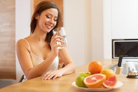 drink water: Young Woman with glass of Water. Healthy Lifestyle Stock Photo
