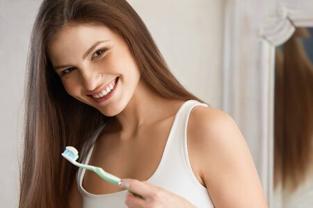 smiling face: Beautiful woman with toothbrush. Dental care . Stock Photo