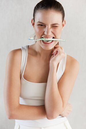 woman washing face: Beautiful woman with toothbrush. Dental care . Stock Photo