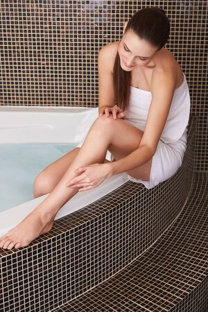 applying: Woman in Bathroom Cares About Her Perfect Legs