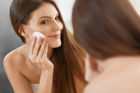 cotton pad: Spa Woman. Beautiful Woman Cleaning Her Face. Cosmetology and Make up. Skincare