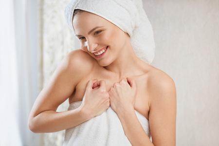 bathroom women: Spa Woman. Portrait of smiling young woman in towel in bathroom.