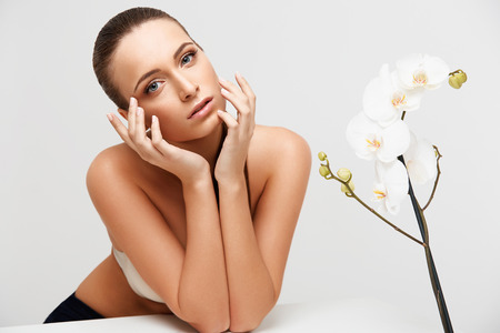 spa woman: Spa Woman. Beautiful Girl Touching Her Face. Perfect Skin. Skincare. Wellness advertising