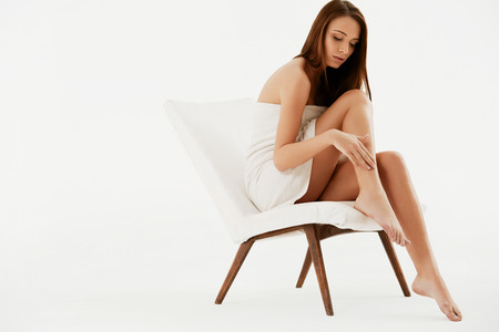 feet naked: Long Woman Legs . Beautiful Woman Cares About Legs. Depilation Stock Photo