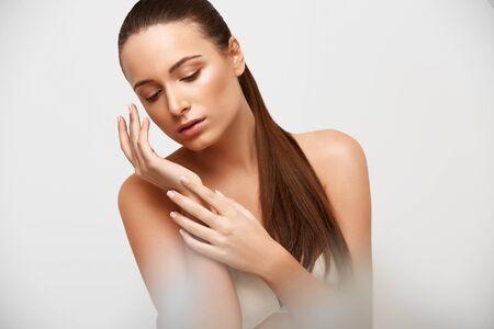 health woman: Spa Woman. Beautiful Girl Touching Her Face. Perfect Skin. Skincare. Young Skin Stock Photo