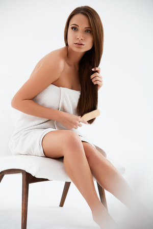 haircare: Brown Hair. Beautiful Brunette with Long Hair. Haircare. Spa Beauty Model